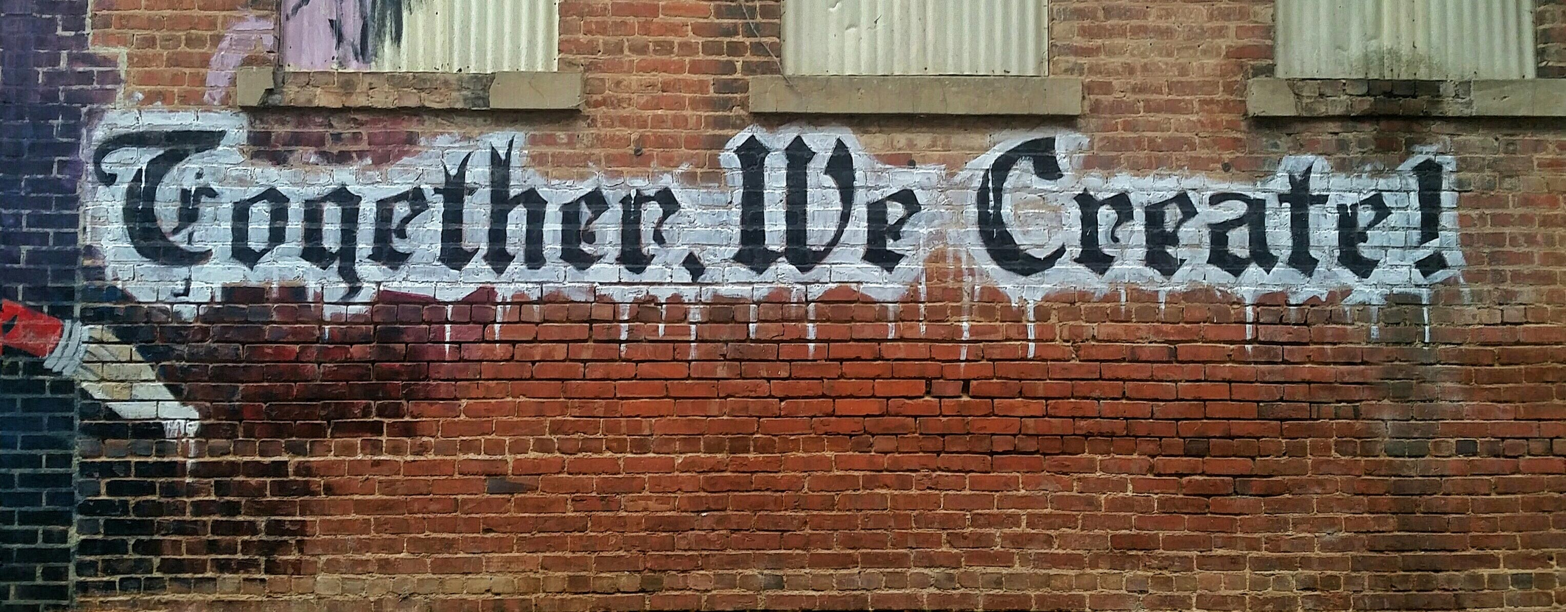 Graffiti saying Together We Create